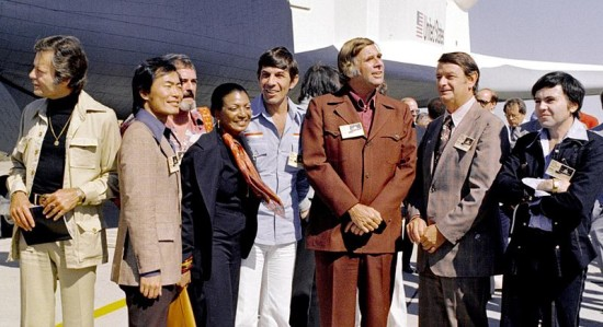 Gene Roddenberry in front of Enterprise