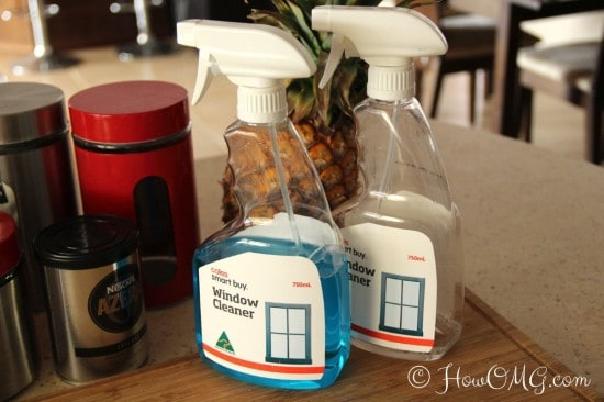 Cleaning products sitting on a kitchen bench